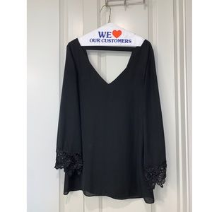 Long Sleeve Low Cut Black Dress with Lace Trim